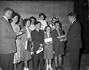 27/05/1959<br /> 05/27/1959<br /> 27 May 1959<br /> Gael-Linn Concert and Singing Competition in the Town Hall, Nenagh, Co. Tipperary, in which R.E. singers and harpists took part. Image shows Mr J.P. Flynn, Tipperary County Manager, presenting prizes to the winners. Included are: Maire Ní Misteil, Sean Seor, Mairtin Misteal, Sile Ní Mhaidin, Nuala Ní Dhubhir, Mired Nic Aodhagain, Philomena NíChuinn and Padraig O Neara (left), Priomh-Timire, Gael-Linn.