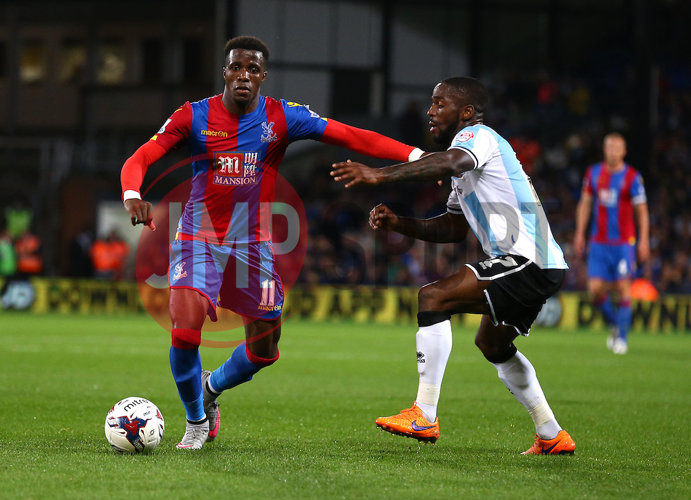 Wilfried Zaha of Crystal Palace and Junior Brown of Shrewsbury Town challenge for the ball - Mandatory byline: Paul Terry/JMP - 07966386802 - 25/08/2015 - FOOTBALL - Selhurst Park -London,England - Crystal Palace v Shrewsbury town - Capital One Cup - Second Round