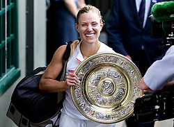 Angelique Kerber with the trophy after winning the Ladies Singles final on day twelve of the Wimbledon Championships at the All England Lawn Tennis and Croquet Club, Wimbledon.