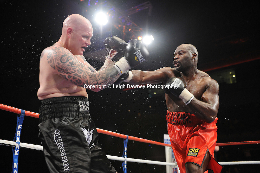 "Larry Olubamiwo defeats Paul Butlin at the Echo Arena, Lverpool,11th December 2010,Frank Warren.tv Promotions ""Return Of The Magnificent Seven"" © Photo Leigh Dawney"