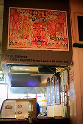 UK ENGLAND LONDON 4NOV12 - Wall art depicting Pakistani wrestlers at the Sweet and Spicy curry diner on Brick Lane in London's trendy east end.....jre/Photo by Jiri Rezac....© Jiri Rezac 2012