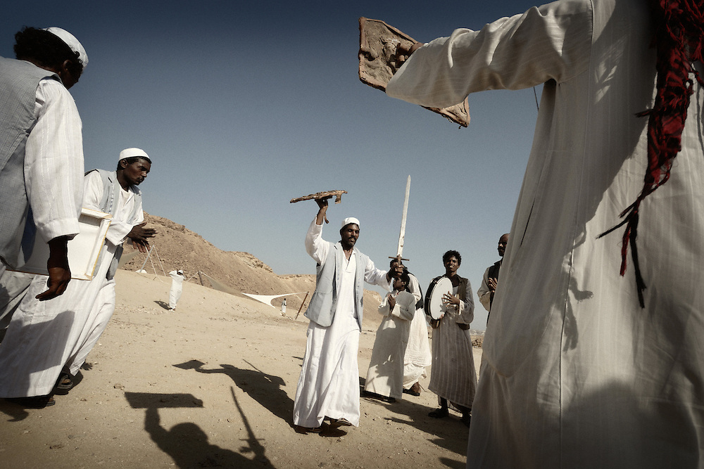 "Ababda bedouins performing ""Maggad"" their traditional dance with swords in Wadi El Gimal, Marsa Alam, Egypt 2010"