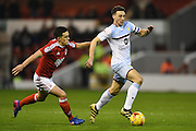 Aston Villa defender James Chester (12) battles with Nottingham Forest forward Zach Clough (16) making his debut during the EFL Sky Bet Championship match between Nottingham Forest and Aston Villa at the City Ground, Nottingham, England on 4 February 2017. Photo by Jon Hobley.