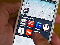Many newspaper applications on homescreen of iPone 5 smartphone