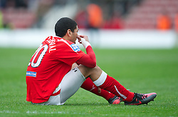 WREXHAM, WALES - Monday, May 7, 2012: Wrexham's Nathaniel Knight-Percival looks dejected as his side lose 3-2 on aggregate (2-1) to Luton Town during the Football Conference Premier Division Promotion Play-Off 2nd Leg at the Racecourse Ground. (Pic by David Rawcliffe/Propaganda)