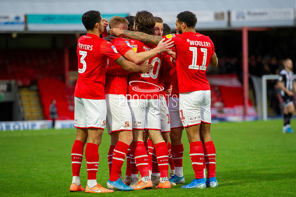 Swindon Town celebrate as Eoin Doyle of Swindon Town scores a goal 0-1 during the EFL Sky Bet League 2 match between Grimsby Town FC and Swindon Town at Blundell Park, Grimsby, United Kingdom on 7 December 2019.