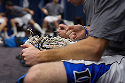 28 May 2007: Duke Blue Devils midfielder Ned Crotty (22) works on his stick pregame in the locker room before playing Johns Hopkins in the NCAA Championship at M&T Stadium in Baltimore, MD.