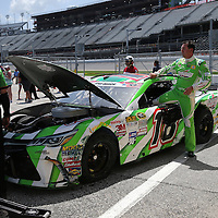 Sprint Cup driver Kurt Busch (18) exits his car after a crash during the 57th Annual NASCAR Coke Zero 400 race first practice session at Daytona International Speedway on Friday, July 3, 2015 in Daytona Beach, Florida.  (AP Photo/Alex Menendez)