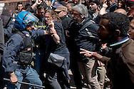 Roma 16 Aprile 2014<br /> Sgomberato palazzo in  via Baldassarre Castiglione alla Montagnola occupato nei giorni scorsi  dai movimenti per il diritto all'abitare da circa  200 persone, la polizia a caricato i manifestanti che protestano per lo sgombero, otto persone sono state ferite.<br /> Rome April 16, 2014 <br /> Vacated the building in Via Baldassarre Castiglione,Montagnola district, busy in recent days by the movements for housing rights, by about 200 people, the police charged the demonstrators protesting the eviction, eight people were injured.