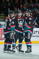 KELOWNA, CANADA - DECEMBER 3: Rourke Chartier #14, Nick Merkley #10 and Riley Stadel #3 of Kelowna Rockets converse on the ice against the Saskatoon Blades on December 3, 2014 at Prospera Place in Kelowna, British Columbia, Canada.  (Photo by Marissa Baecker/Shoot the Breeze)  *** Local Caption *** Nick Merkley; Rourke Chartier; Riley Stadel;