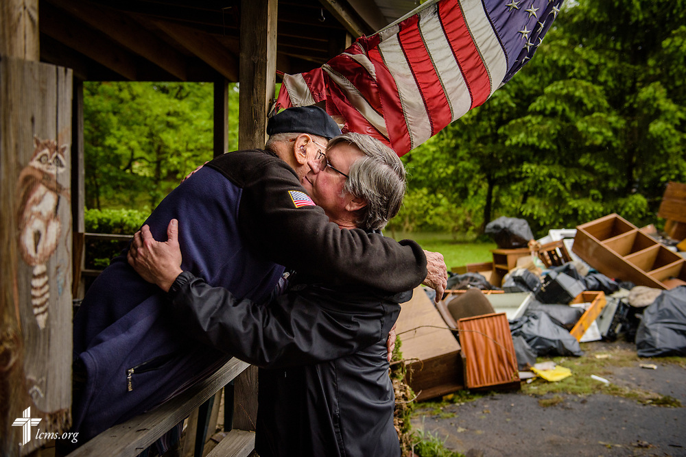Dick Keezer (left), a church member and flood victim, hugs his pastor, the Rev. Steve Gillmore of First Lutheran Church, Neosho, Mo., during a visitation with Keezer at his flood-damaged home on Wednesday, May 3, 2017, in Neosho. LCMS Communications/Erik M. Lunsford