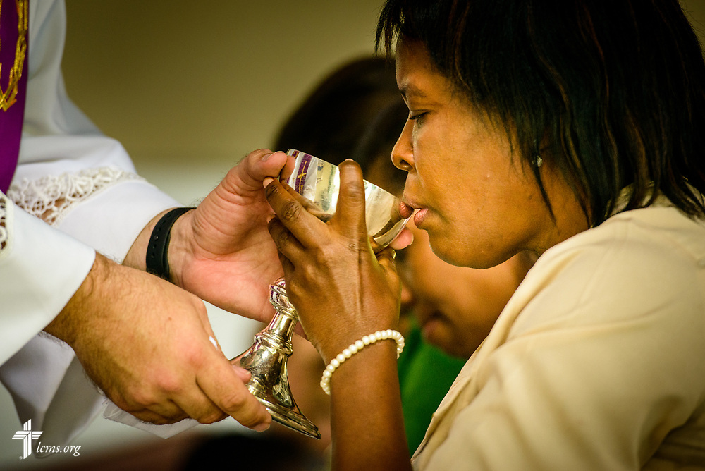 A church member receives the Sacrament during worship led by the Rev. Joel Fritsche, LCMS career missionary to the Dominican Republic, on Sunday, March 19, 2017, at Amigos de Cristo Iglesia Luterana in Las Americas (Friends of Christ Lutheran Church in the Americas) in Santo Domingo, Dominican Republic. LCMS Communications/Erik M. Lunsford