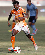 Jun 29, 2016; Houston, TX, USA; Houston Dynamo midfielder Abdoulie Mansally (20) dribbles against the Sporting Kansas City in the fist half at BBVA Compass Stadium. Mandatory Credit: Thomas B. Shea-USA TODAY Sports