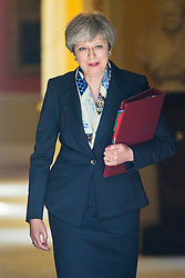© Licensed to London News Pictures. 21/06/2017. London UK. Prime minister Theresa May leaves number 10 this morning heading to Parliament for the Queens speech marking the opening of Parliament. This years speech is expected to be overshadowed by 'day of rage protests' by left wing campaigners.  Photo credit: Andrew McCaren/LNP