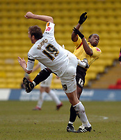 Photo: Leigh Quinnell.<br /> Watford v Luton Town. Coca Cola Championship. 09/04/2006. Watfords Lloyd Doyley ends up on the end of Luton Steve Howards boot.