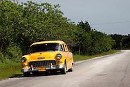 Yellow car in Velasco, Holguin, Cuba.