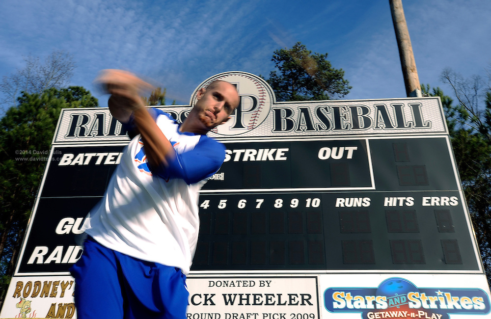 New York Mets pitcher Zack Wheeler, swings near the scoreboard he donated to his East Paulding County High School baseball team in Powder Springs, Ga., Monday, Jan. 21, 2013.   (David Tulis)