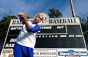 New York Mets pitcher Zack Wheeler, swings near the scoreboard he donated to his East Paulding County High School baseball team in Powder Springs, Ga., Monday, Jan. 21, 2013.   (David Tulis)