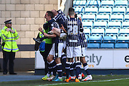 Martyn Woolford of Millwall (left) celebrates scoring the opening goal during the Sky Bet Championship match at The Den, London<br /> Picture by David Horn/Focus Images Ltd +44 7545 970036<br /> 03/05/2014