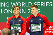 Tom Daley of Great Britain and Matty Lee of Great Britain smile on the podium after winning the Men's Syncronised 10m dive during the FINA/CNSG Diving World Series 2019 at London Aquatics Centre, London, United Kingdom on 17 May 2019.