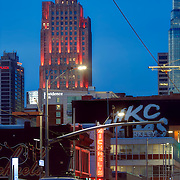 Main Street traffic in downtown Kansas City and Power and Light Apartments highrise in background.