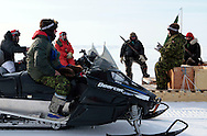 Canadian Rangers pause as they rides snowmobiles on the ice shelf next to their camp in Baring Bay on Devon Island during Nunalivut 2012 sovereignty exercise. Rangers are non-combat, part-time reserve auxiliaries that mix local volunteers and professional military acting as eyes and ears in the most remote areas of northern Canada.