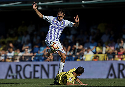 September 30, 2018 - Vila-Real, Castellon, Spain - Michel (L) of Real Valladolid competes for the ball with Manu Trigueros of Villarreal CF during the La Liga match between Villarreal CF and Real Valladolid at Estadio de la Ceramica on September 30, 2018 in Vila-real, Spain  (Credit Image: © David Aliaga/NurPhoto/ZUMA Press)