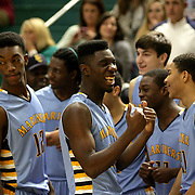 East Carteret celebrates winning the Leon Brogden Holiday Basketball Tournamnet. (Jason A. Frizzelle)