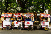 30th June 2015, New Delhi. Ice cream vendors sleep on top of their carts in New Delhi, India on the 30th June 2015<br /> <br /> Sleeping in the outdoors is common in Asia due to a warmer climate and the fact that personal privacy for sleep is not so culturally ingrained as it is in the West. New Delhi (where most of these images were taken) is a harsh city both in climate and environment and for those working long hours, often in hard manual labour, sleep and rest is something fallen into when exhaustion overwhelms, no matter the place or circumstance. Then there are the homeless, in Delhi figures for them from Government and NGO sources vary wildly from 25,000 to more than 10 times that. Others public sleepers may simply be travellers having a siesta along the way.<br />  <br /> <br /> PHOTOGRAPH BY AND COPYRIGHT OF SIMON DE TREY-WHITE, photographer in Delhi<br /> <br /> + 91 98103 99809<br /> email: simon@simondetreywhite.com