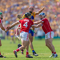 Clare's Peter Duggan is surrounded by Cork's Eoin Cadigan, Colm Spillane and Sean O'Donoghue