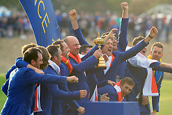 Team Europe captain Thomas Bjorn (centre) and his team celebrate with the Ryder Cup during day three of the Ryder Cup at Le Golf National, Saint-Quentin-en-Yvelines, Paris.