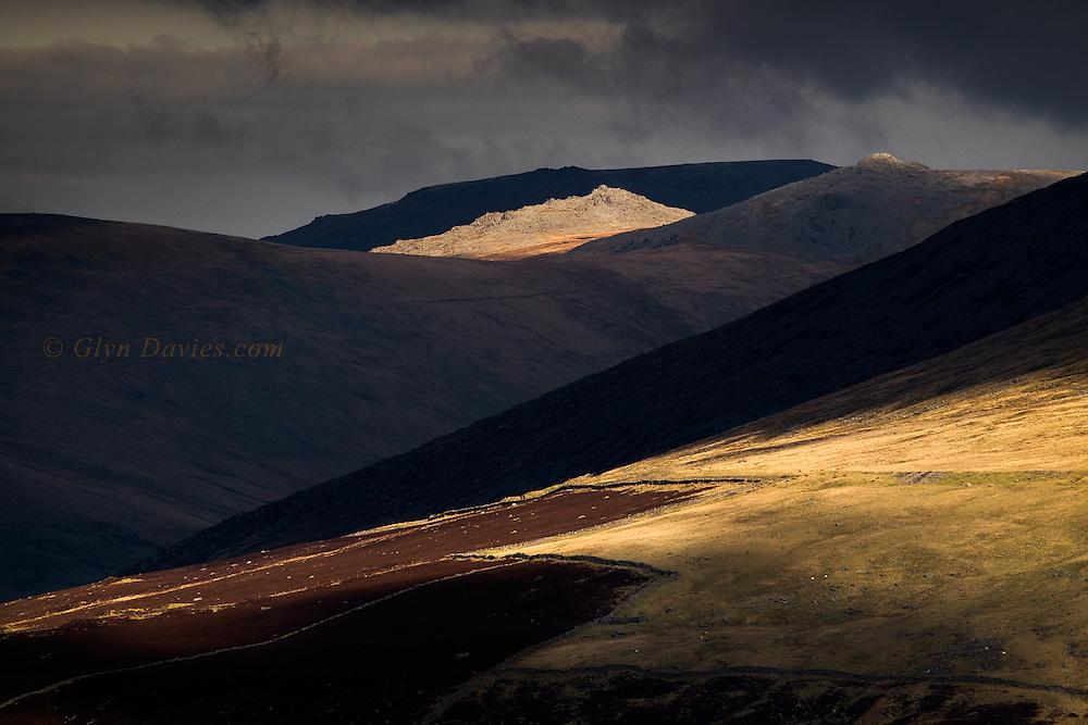 Glimpses of sunshine across successive hillsides in the heart of Snowdonia.
