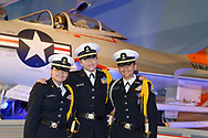 Garden City, New York, U.S. June 6, 2019. Three Freeport High School Navy Junior ROTC cadets wearing uniforms and about to participate at Apollo at 50 Anniversary Dinner at Cradle of Aviation Museum, pose for photo in front of historic aircraft at museum exhibit.