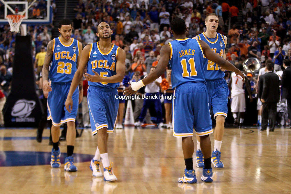 Mar 19, 2011; Tampa, FL, USA; UCLA Bruins players leave the court at halftime against the Florida Gators during the third round of the 2011 NCAA men's basketball tournament at the St. Pete Times Forum.  Mandatory Credit: Derick E. Hingle