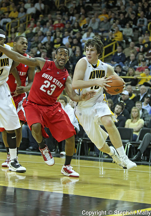 January 04 2010: Iowa Hawkeyes forward Zach McCabe (15) tries to get around Ohio State Buckeyes guard/forward David Lighty (23) during the first half of an NCAA college basketball game at Carver-Hawkeye Arena in Iowa City, Iowa on January 04, 2010. Ohio State defeated Iowa 73-68.