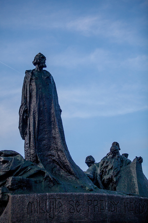 "The monument of Jan Hus at the Prague Old Town Square was designed by Ladislav Saloun. The foundation stone was laid down in 1903 and the monument was unofficially revealed on 6 th July 1915, the 500th anniversary of Jan Hus´s death. The  inscription reads: ""Love each other and wish the truth to everyone"" (Jan Hus´s words), ""Live, nation sacred in God, don´t die"", ""I believe, that the anger thunders will cease and that the government of your affairs will return to your hands, Czech folk"" and ""Who are the warriors of God and his law"" (words from the anthem of the Hussite warriors)."