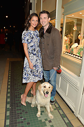 JULES KNIGHT and JO RENWICK with their dog Honey at a preview of the latest collections by jewellery designer Kiki Mcdonough and fashion label Beulah held at Kiki McDonough Jewellery, 12 Symons Street, London on 5th March 2014.