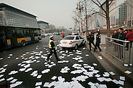 Chinese police arrive to the seen where petitioners threw written accounts of their grievances in the air at a busy shopping street, near Tiananmen square, in hopes to have her case seen and heard by a larger audience, after failed attempts to have their cases heard at the Petition's office  in  Beijing, China, Tuesday, March 3, 2009. Widespread frustration with the petition system is simmering and in several recent cases has boiled over, with a handful of people making desperate bids for attention. The peak season for the pilgrimages is the beginning of March, when China's lawmakers gather in the capital for their once-a-year legislative session. In an acknowledgement that the petition system is in crisis, China's Premier Wen Jiabao vowed to improve legal channels for grievances.