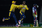 Hampshire T20 all-rounder Darren Sammy and James Vince celebrating during the NatWest T20 Blast South Group match between Hampshire County Cricket Club and Kent County Cricket Club at the Ageas Bowl, Southampton, United Kingdom on 2 June 2016. Photo by David Vokes.