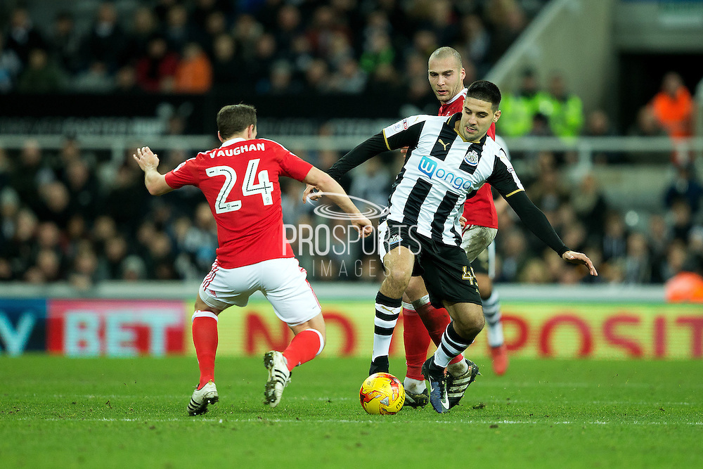 Newcastle United forward Aleksandar Mitrovic (#45) is challenged by Nottingham Forest midfielder David Vaughan (#24) during the EFL Sky Bet Championship match between Newcastle United and Nottingham Forest at St. James's Park, Newcastle, England on 30 December 2016. Photo by Craig Doyle.