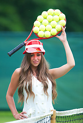 LIVERPOOL, ENGLAND - Thursday, June 20, 2013: Faye Ayers, former Miss Liverpool, models a tennis hat made especially for the Liverpool Hope University International Tennis Tournament by designer Hayley Marsden. (Pic by David Rawcliffe/Propaganda)