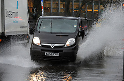 © Licensed to London News Pictures. 12/02/2014<br /> Flooded roads in Orpington,Kent.<br />  Bad weather in the South East this afternoon (12.02.2014)<br /> with heavy rain and gale force winds.<br /> Photo credit :Grant Falvey/LNP