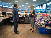 01 NOVEMBER 2019 - DES MOINES, IOWA: JULIAN CASTRO, former Secretary of Housing and Urban Development in the Obama Administration, talks to EMILY OSWEILER at the YMCA Supportive Housing Campus. Secretary Castro, who is running for the Democratic nomination for the US presidency, toured the YMCA Supportive Housing Campus in downtown Des Moines Friday. The campus is the only project of its type in the US. It provides transitional housing in the form of individual apartments (rather than dorms) for at risk people rent is needs tested so poverty does not prevent people from getting apartments. There are about 140 apartments in the complex, the YMCA has a waiting list of 119 people. Castro toured the campus before he spoke at the Liberty and Justice Celebration downtown.                PHOTO BY JACK KURTZ