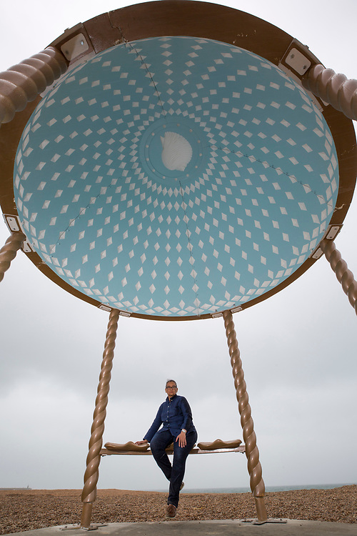 Turner Prize nominated Lubaina Himid MBE with her Jelly Mould Pavilion on Folkestone's sea front as part of the 2017 Folkestone Triennial. Folkestone, Kent. Lubaina Himid created a Jelly Mould Pavilion on Folkestone's sea front, on the former 'Rotunda' site of the town's fun fair, Lido and amusement park where the sugar of candy floss and toffee apples fuelled summer visitors. The pavilion's colourful decoration in the artist's signature patterning will serve as a reminder of the lost amusement park, as well as providing a beautiful shelter at the edge of the town to rest, look out to sea, and think about the role of sugar in Britain's history. Folkestone, Kent. (photo by Andrew Aitchison / In pictures via Getty Images)