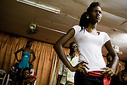 Nana Yaa Adadewa Addo, 24, prepares to practice her catwalk while other models wait for their turn during a rehearsal in Ghana's capital Accra on Thursday May 21, 2009. Nana Yaa is one of several Ghanaian girls who auditioned for the upcoming television show West Africa's Next Top Model, the latest incarnation of Tyra Banks' America's Next Top Model.