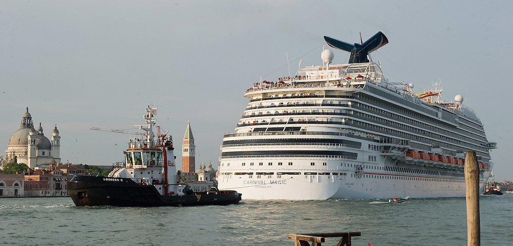 VENICE, ITALY - MAY 02: Cruise ship Carnival Magic is seen in St Mark Basina on the day is being officially named and starts her first cruise on May 1, 2011 in Venice, Italy. Giant cruise ships passing through  St Mark Basin and Giudecca Canal are causing continue controversy for the possible damages to the lagoon and Venice buildings