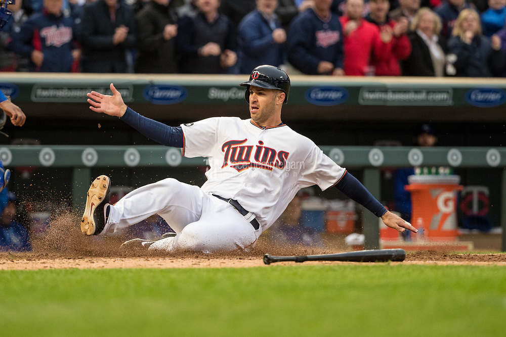 MINNEAPOLIS, MN- APRIL 3: Joe Mauer #7 of the Minnesota Twins slides against the Kansas City Royals on April 3, 2017 at Target Field in Minneapolis, Minnesota. The Twins defeated the Royals 7-1. (Photo by Brace Hemmelgarn) *** Local Caption *** Joe Mauer