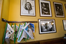 Detail of newspaper rack and photographs on wall of famous Cafe Einstein on Unter den Linden in Berlin