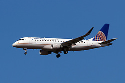 Embraer ERJ 170-200 LR (N151SY) operated by SkyWest Airlines for United Express on approach to San Francisco International Airport (KSFO), San Francisco, California, United States of America