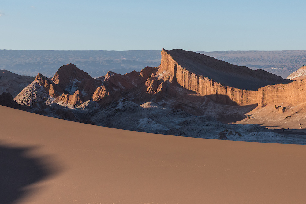 A big sanddune and moonlike landscape of the Valley of the Moon, Chile